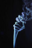 Thin curl of smoke rises up Royalty Free Stock Photography