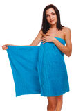 Thin curly slim girl woman brunette in blue towel after bath and Royalty Free Stock Photography