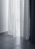 Thin curtains soft light. Soft light coming in apartment through thin white curtains Stock Image