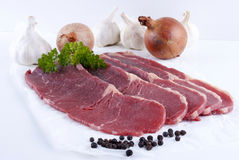 Thin cut beef steaks Stock Photos