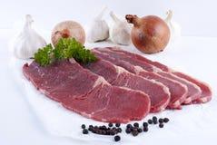 Thin cut beef steaks Stock Photos