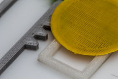 Thin 3D printed gear with visible layers of plastic that is sustainable. 3D printing or additive manufacturing is a process of making three dimensional solid stock photo