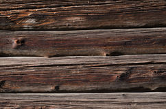 Thin dark old wooden boards with light spots, are horizontally arranged Stock Photos