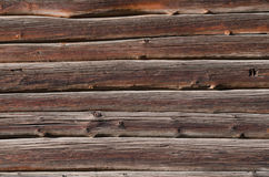 Thin dark wooden planks with light spots, are horizontally arranged Stock Image
