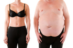 Thin and fat. Young slim woman beneath a very fat man Stock Image