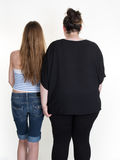Thin and fat or obese woman standing isolated on white Royalty Free Stock Photos