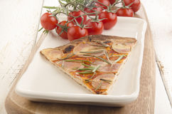 Thin flat bread pizza with potato Stock Photo