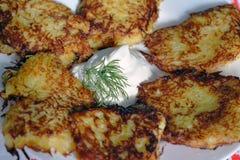 Thin fried golden potato pancakes Stock Image