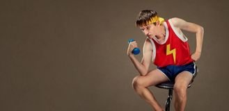 A thin funny guy in sports clothes in the pose of the Greek thin Stock Photo