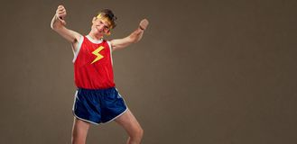 A thin funny guy in sports clothes shows his finger down Royalty Free Stock Image
