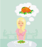 Thin girl is dreaming of a roast chicken Royalty Free Stock Images
