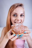 Thin girl eats donut. Vertical view of thin girl eats donut Stock Image