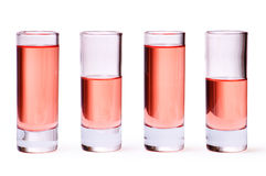 Thin glasses with pink liquid Royalty Free Stock Images