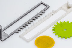 Thin green 3D printed gear with visible layers of plastic that is sustainable. 3D printing or additive manufacturing is a process of making three dimensional stock photography