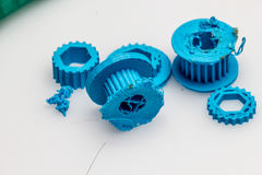 Thin green 3D printed gear with visible layers of plastic that is sustainable. 3D printing or additive manufacturing is a process of making three dimensional Royalty Free Stock Photos