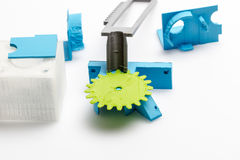 Thin green 3D printed gear with visible layers of plastic that is sustainable. 3D printing or additive manufacturing is a process of making three dimensional stock images