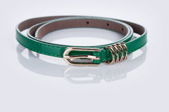 Thin green female belt buckle with fine Stock Image