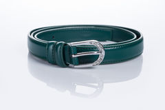 Thin green female belt buckle with fine Royalty Free Stock Images
