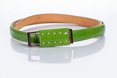 Thin green female belt buckle with fine Stock Photos