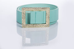 Thin green female belt buckle with fine Stock Photo
