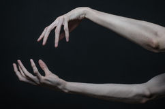 Thin hands of death Stock Photo
