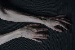 Thin hands of death Stock Photos