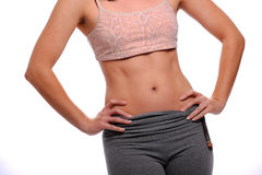 Thin healthy female wearing fitness clothing Stock Image