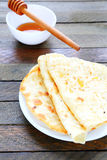 Thin homemade pita and honey Stock Image