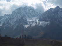 Thin ice cover on  overlap blue mountain in kashmir,india Royalty Free Stock Photo