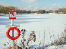 Thin ice sign. Of a lake Stock Photography