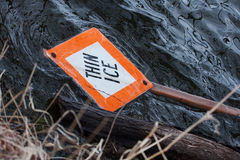 Thin Ice sign in water Stock Images