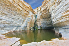 Thin jet waterfall form cold lake Stock Photo