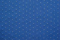 Thin knitted fabric of blue color with blond specks Royalty Free Stock Image
