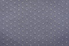 Thin knitted fabric of gray lilac color with blond specks Stock Image