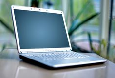 Thin laptop on office Royalty Free Stock Image