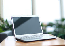 Thin laptop on office desk Stock Photos