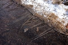 Thin layer of ice on the asphalt and dirty snow close. Thin layer of ice on the asphalt and dirty snow Royalty Free Stock Photography