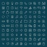 100 thin line universal icons set  of finance, marketing, shoppi. Ng, weather, internet, user interface, navigation, media,  on dark background on blue Royalty Free Stock Image