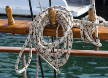 Thin long sturdy rope on a sailing boat Stock Photos