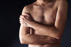 Thin man torso. Shirtless male with crossed hands Stock Photo
