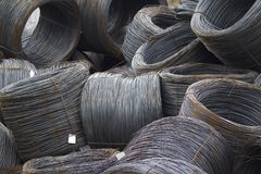 Thin metal reinforcement wound into bays at the metal products warehouse. Russia Stock Photo