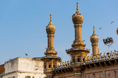 Thin minarets of a mosque with pigeons sitting Royalty Free Stock Images