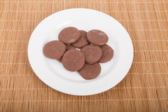 Thin Mint Cookies on White Plate and Bamboo Mat Royalty Free Stock Image