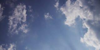 A thin, moving white cloud