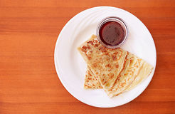 Thin pancake with jam on the table Royalty Free Stock Image