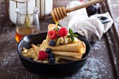 Thin pancakes with apples and fresh berry Royalty Free Stock Image