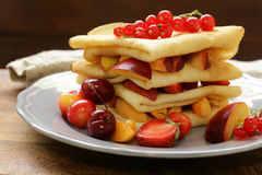 Thin pancakes with berries and fruits Royalty Free Stock Images
