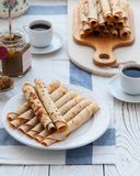 Thin pancakes for breakfast. Maslenitsa. On the table, a dish with pancakes, coffee and jam from feijoa stock photo