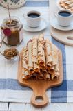 Thin pancakes for breakfast. Maslenitsa. On the table, a dish with pancakes, coffee and jam from feijoa royalty free stock photo
