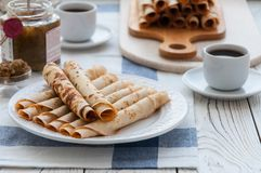 Thin pancakes for breakfast. Maslenitsa. On the table, a dish with pancakes, coffee and jam from feijoa stock photography
